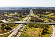 Nederland, Utrecht, Gemeente Eemnes, 01-05-2013; ontstaan van file op knooppunt Eemnes, kruising A1 (Amsterdam - Amersfoort) en A27 (Hilversum-Almere). Foto richting Amsterdam. <br /> Zendmast links aan de horizon, bossen van 't Gooi.<br /> Development of a traffic jam on Junction Eemnes, A27/A1 (central Netherlands)<br /> luchtfoto (toeslag op standard tarieven)<br /> aerial photo (additional fee required)<br /> copyright foto/photo Siebe Swart