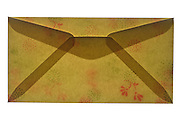 a closed letter envelope with ornamental flower decoration