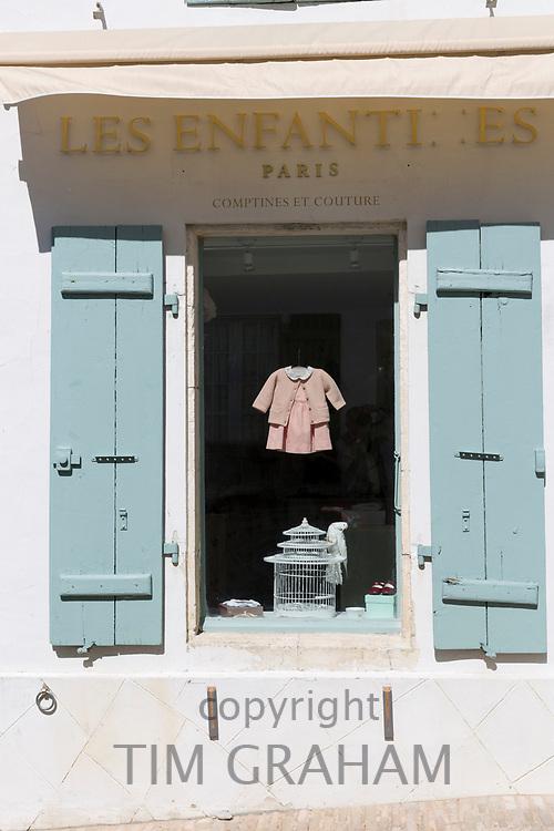 Shop window of children's clothes shop Les Enfantines and gifts on sale in Les Portes en Re, Ile de Re, France