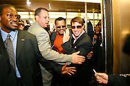 Actor Tom Cruise (L) and Laurence Fishburne (Orange shirt) boards a New York City subway train during a promotional tour of New York for his new movie 'Mission Impossible 3' , Wednesday 03 May 2006. Cruise is attending a number of different events around the city and travelling by a number of different forms of transportation.