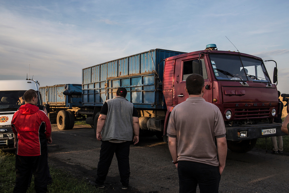 GRABOVO, UKRAINE - JULY 19: A truck carrying the bodies of some of the passengers of Malaysia Airlines flight MH 17 leaves the scene of the crash after pro-Russia separatist fighters established control of the site on July 19, 2014 in Grabovo, Ukraine. Malaysia Airlines flight MH17 was travelling from Amsterdam to Kuala Lumpur when it crashed killing all 298 on board including 80 children. The aircraft was allegedly shot down by a missile and investigations continue over the perpetrators of the attack. (Photo by Brendan Hoffman/Getty Images) *** Local Caption ***