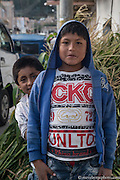 Curious kids pose for a portrait on the streets of Caraz, Peru.