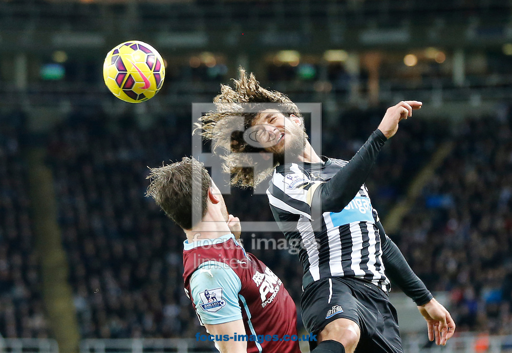 Fabricio Coloccini (r) of Newcastle United clears under pressure from Ashley Barnes of Burnley during the Barclays Premier League match at St. James's Park, Newcastle<br /> Picture by Simon Moore/Focus Images Ltd 07807 671782<br /> 01/01/2015