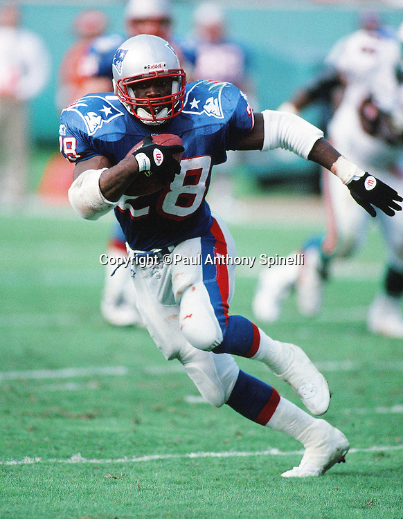 New England Patriots running back Curtis Martin (28) runs the ball during the NFL football game against the Miami Dolphins on Nov. 12, 1995 in Miami Gardens, Fla. The Patriots won the game 34-17. (©Paul Anthony Spinelli)