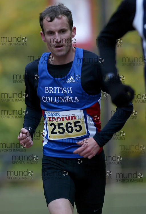 """(Toronto, Ontario -- 17 Oct 2009) RYAN MCKENZIE works hard to race up the long boardwalk hill by the tiger enclosure in the 2009 OASIS Zoo Run 10K run and Athletics Canada national 10 km road racing championship at the Toronto Zoo. [Photo credit should read """"Sean Burges / Mundo Sport Images""""]"""