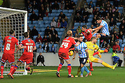 Coventry City defender Aaron Martin heads home opening goal during the Sky Bet League 1 match between Coventry City and Oldham Athletic at the Ricoh Arena, Coventry, England on 19 December 2015. Photo by Alan Franklin.