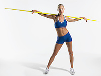 Female athlete holding javelin behind shoulders