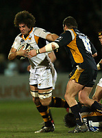 Photo: Rich Eaton.<br /> <br /> Worcester Rugby v London Wasps. Guinness Premiership. 26/01/2007. Dan Leo of Wasps is tackled by Worcesters Chris Horsman #3