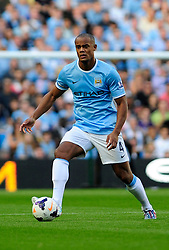 Manchester City's Vincent Kompany - Photo mandatory by-line: Dougie Allward/JMP - Tel: Mobile: 07966 386802 22/09/2013 - SPORT - FOOTBALL - City of Manchester Stadium - Manchester - Manchester City V Manchester United - Barclays Premier League