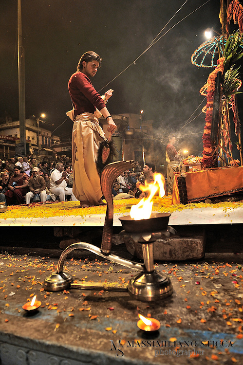 The large brass lamps with snake hood, full of  camphor or kapoor. The burning of kapoor generates big flames out from the lamps and when the priests wave and circle them identically, it mesmerizes everyone.