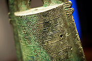 Photo shows a detail from a bronze bell dating back around 2,000 years and excavated from the Kamo-Iwakura site on display at the Shimane Museum  of Ancient Izumo, which was designed by Maki Fumihiko,  in Izumo City, Shimane Prefecture, Japan on 05 Nov. 2012.  The bells are designated important cultural properties. In 1996, 39 bronze vessels (bronze bells) were excavated -- the largest number excavated from a single site in Japan. These bronze implements are thought to have been used in the religious festivals and are evidence that the Gods festivals in Izumo were regarded as highly significant.  Photographer: Robert Gilhooly