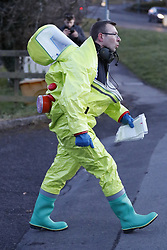 © Licensed to London News Pictures. 07/03/2018. Salisbury, UK. An emergency worker is seen in a hazardous material suit after police were seen putting on protective suits and gas masks near Salisbury. Former Russian spy Sergei Skripal and his daughter were taken ill following a suspected poisoning in the city. The couple where found unconscious on bench in Salisbury shopping centre. Specialist units have been called in to deal with any possible contamination. Photo credit: Peter Macdiarmid/LNP
