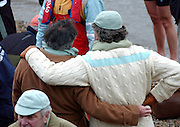 CAMBRIDGE SUPPORTERS CONSOLE EACH OTHER  AFTER THE 149TH OXFORD CAMBRIDGE BOAT RACE.OXFORD BEAT CAMBRIDGE BY THE SHORTEST OF MARGINS,ONE FOOT.6.4.03.PIX STEVE BUTLER