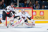 KELOWNA, CANADA - OCTOBER 24: Brendan Burke #1 of Calgary Hitmen defends the net against the Kelowna Rockets on October 24, 2015 at Prospera Place in Kelowna, British Columbia, Canada.  (Photo by Marissa Baecker/Shoot the Breeze)  *** Local Caption *** Brendan Burke;