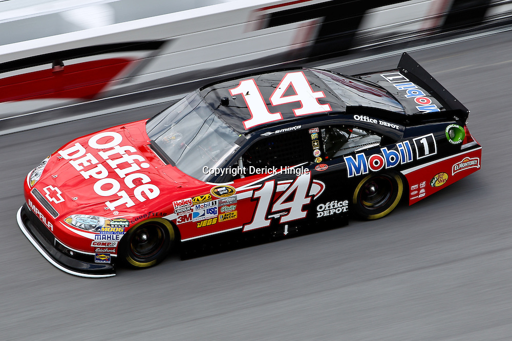 April 16, 2011; Talladega, AL, USA; NASCAR Sprint Cup Series driver Tony Stewart (14) during qualifying for the Aarons 499 at Talladega Superspeedway.   Mandatory Credit: Derick E. Hingle