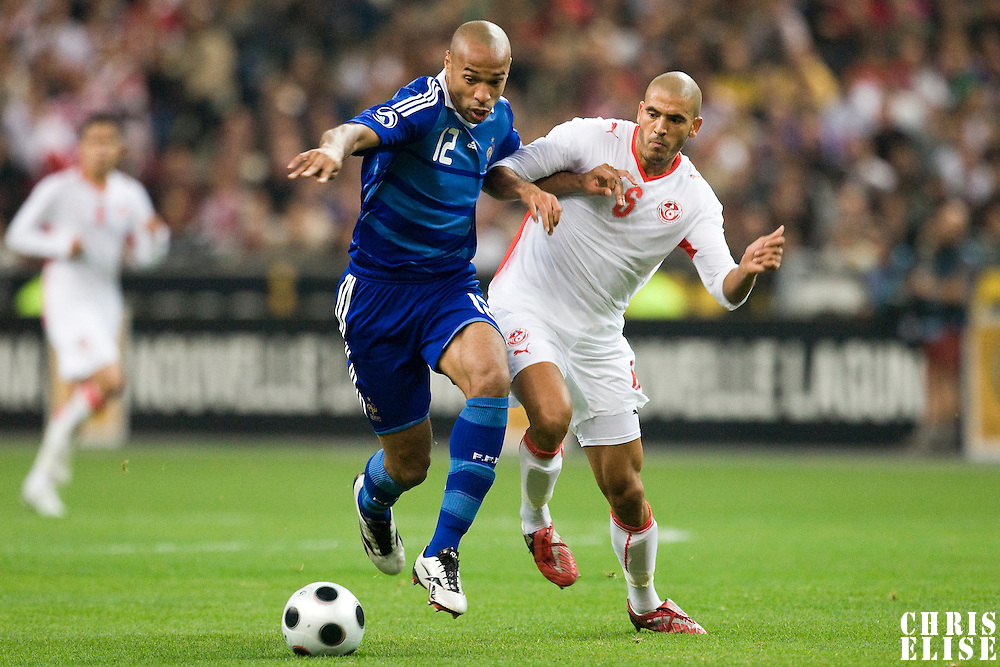 14 October 2008: French forward Thierry Henry #12 vies with Tunisian midfielder Houcine Ragued #6 during the friendly football match won 3-1 by France over Tunisia on October 14, 2008, at the Stade de France in Saint-Denis, near Paris, France.