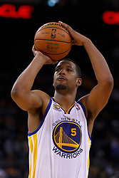 Mar 16, 2012; Oakland, CA, USA; Golden State Warriors small forward Dominic McGuire (5) shoots a free throw against the Milwaukee Bucks during the fourth quarter at Oracle Arena. Milwaukee defeated Golden State 120-98. Mandatory Credit: Jason O. Watson-US PRESSWIRE