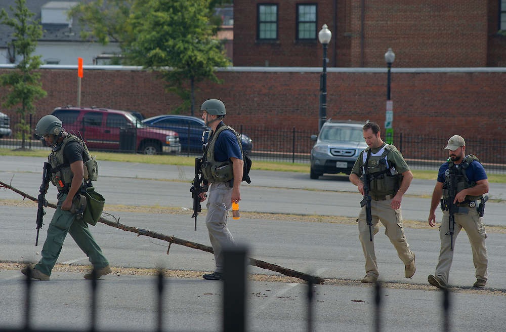 """DISTRICT OF COLUMBIA (Sept. 16, 2013) -- U.S. Marshals secure from the Washington Navy Yard where 13 people including an assailant were killed that started on Monday morning.  The shooter fired inside the Naval Sea Systems Command Headquarters building around 8:15 a.m. where a host of law enforcement agencies from the Metropolitan Police Department, Military Police, U.S. Marshals and others assisted with the response. There was a """"shelter in place"""" order while law enforcement agencies entered the building to confront the shooter who was killed.  Photo by Johnny Bivera"""
