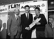 10/01/1986.01/10/1986.10th January 1986.The Aer Lingus Young Scientist of the Year Exhibition at the RDS, Dublin...Picture shows Con Power, (left) Director, Economic Policy, Confederation of Irish Industries, presenting the CII Award for the Physical, Mathematical and Applied Sciences, Intermediate Pupils, to Brian Gribben of St. Olcan's Secondary School, Randlestown, Co. Antrim. Also pictured is Niall G. Weldon, Chairman of the Panel of Judges. Brian's winning project was entitled 'Computer Controlled Pig Feed Unit'. Also pictured (left) is Michael Dargan, Chairman of Aer Lingus. ...
