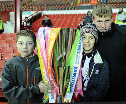 Bristol City fans pose with the Johnstone's Paint Trophy ahead of the south area final second leg match between Bristol City and Gillingham at Ashton Gate on 29 January 2015 in Bristol, England - Photo mandatory by-line: Paul Knight/JMP - Mobile: 07966 386802 - 29/01/2015 - SPORT - Football - Bristol - Ashton Gate Stadium - Bristol City v Gillingham - Johnstone's Paint Trophy