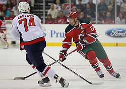 Mar 18; Newark, NJ, USA; New Jersey Devils left wing Ilya Kovalchuk (17) skates with the puck while Washington Capitals defenseman John Carlson (74) defends during the second period at the Prudential Center.