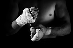 Boxer applying hand wraps.