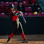 02 March 2018: San Diego State softball hosts Minnesota on day two of the San Diego Classic I at Aztec Softball Stadium. San Diego State catcher Alizae Umi (15) hits an rbi single to tie the game at 1-1  in the bottom of the second inning. The Aztecs beat the #21/20 Gophers 6-2.<br /> More game action at sdsuaztecphotos.com