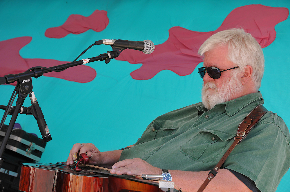 Guitarist and vocalist Sandy Staples performing with Buffelgrass during their concert at the 2012 Tucson Folk Festival in Downtown Tucson, Arizona.