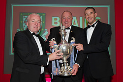 CARDIFF, WALES - Monday, October 4, 2010: Bangor manager Neville Powell, FAW Vice-President Trefor Lloyd-Hughes and Jamie Brewerton with the Welsh Cup at the Brains Football Association of Wales Player of the Year Awards. (Pic by David Rawcliffe/Propaganda)