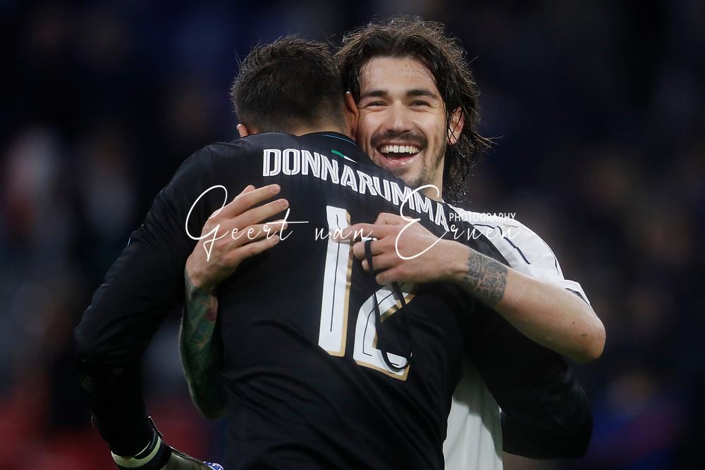 28-03-2017 VOETBAL:NEDERLAND - ITALIE:AMSTERDAM<br /> Alessio Romagnoli of Italy viert de overwinning met Gianluigi Donnarumma of Italy <br /> <br /> <br /> Foto: Geert van Erven