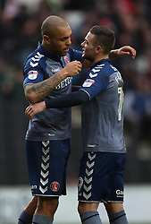 Charlton Athletic's Josh Magennis is congratulated by team mate after scoring his sides second goal during the Sky Bet League One match at Stadium MK, Milton Keynes .