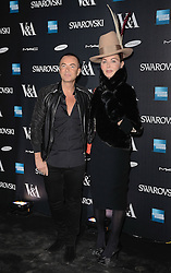 Julian Macdonald and guest attend The Alexander McQueen: Savage Beauty VIP private view at The Victoria and Albert Museum, Cromwell Road, London on Saturday 14 March 2015