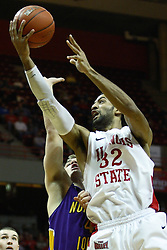 29 December 2011:  Jackie Carmichael gets a lay up after dodging Chip Rank during an NCAA mens basketball game between the Northern Illinois Panthers and the Illinois State Redbirds in Redbird Arena, Normal IL