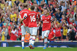 Arsenal's Per Mertesacker Arsenal's Aaron Ramsey and Arsenal's Mesut Ozil celebrate a goal - Photo mandatory by-line: Mitchell Gunn/JMP - Tel: Mobile: 07966 386802 22/09/2013 - SPORT - FOOTBALL - Emirates Stadium - London - Arsenal V Stoke City - Barclays Premier League