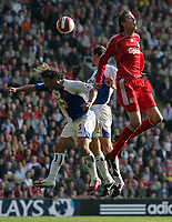 Photo: Paul Thomas.<br /> Liverpool v Blackburn Rovers. The Barclays Premiership. 14/10/2006.<br /> <br /> Peter Crouch (R) of Liverpool wins the ball from Blackburn pair Tugay (L) and Andre Ooijer (C).