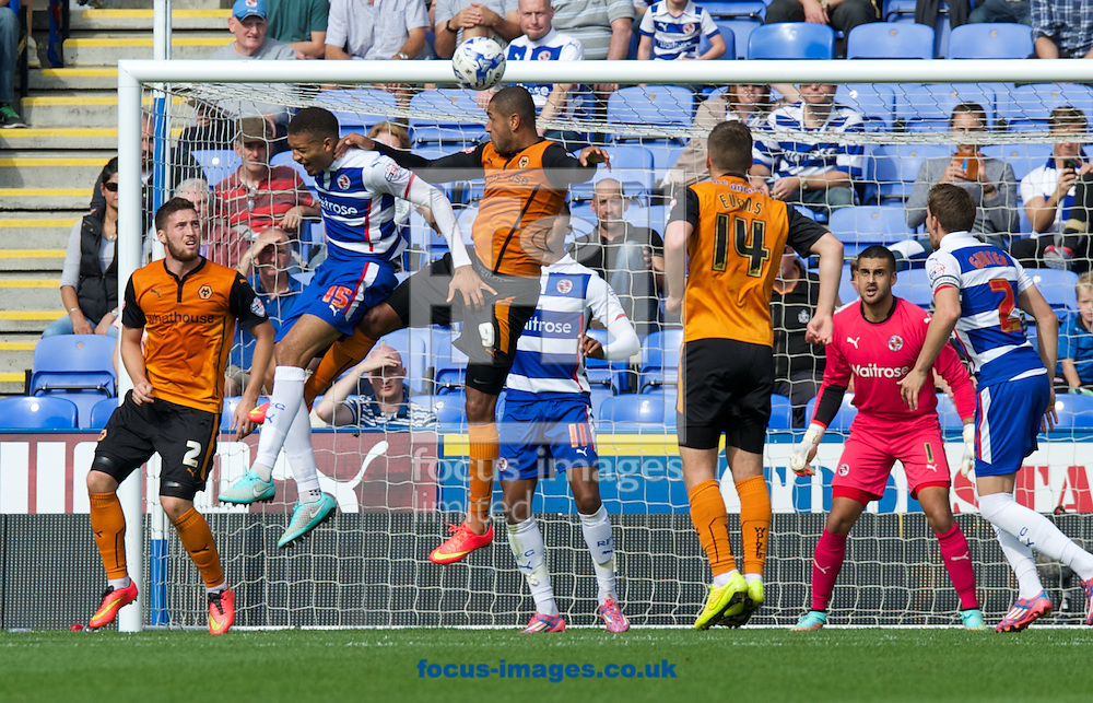 Michael Hector of Reading challenges Leon Clarke of Wolverhampton Wanderers to the header in the goalmouth during the Sky Bet Championship match at the Madejski Stadium, Reading<br /> Picture by Alan Stanford/Focus Images Ltd +44 7915 056117<br /> 28/09/2014