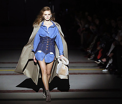 February 3, 2018 - Kyiv, Ukraine - A model wears a denim shirt under a denim corset topped by a coat during The Coat by Katya Silchenko AW 18/19 catwalk show at the Ukrainian Fashion Week, Kyiv, capital of Ukraine, February 3, 2018. Ukrinform. (Credit Image: © Pavlo Bagmut/Ukrinform via ZUMA Wire)