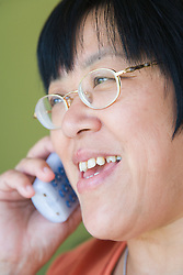Woman talking on the telephone,