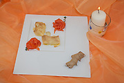 crepes with smoked salmon filling on white dish and orange veil background with candle, view from above, italian food