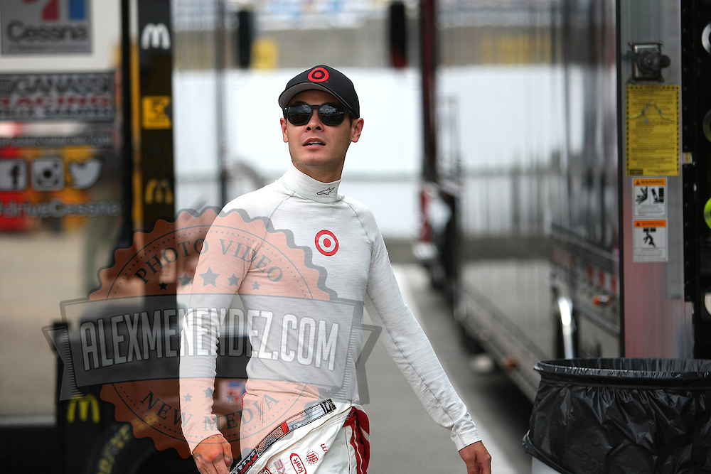 Driver Kyle Larson is seen in the pit area during the first practice session of the 56th Annual NASCAR Coke Zero400 race at Daytona International Speedway on Thursday, July 3, 2014 in Daytona Beach, Florida.  (AP Photo/Alex Menendez)
