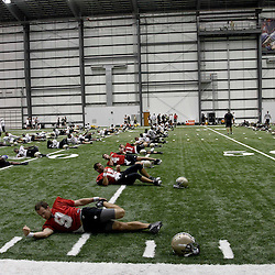 July 27, 2012; Metairie, LA, USA; New Orleans Saints quarterback Drew Brees (9) stretches with teammates during training camp at the team's indoor practice facility. Mandatory Credit: Derick E. Hingle-US PRESSWIRE