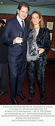COUNT & COUNTESS MICHEL DE LIEDEKERKE at a party in London on 13th January 2003.<br />