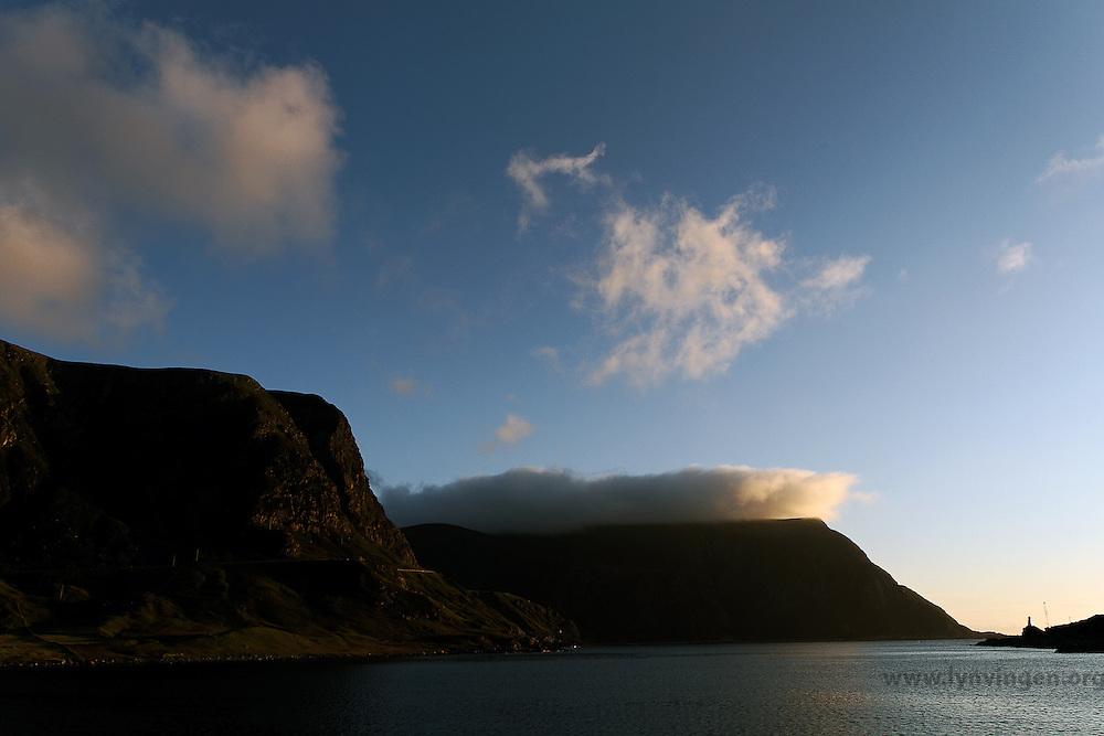Kjerringa, Vestkapp at Stad seen from Honningsvåg - early morning. Morgensol over Kjerringa, også kalt Vestkapp, sett fra Honningsvåg, Sogn og Fjordane