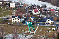 Poland, Wisla Malinka - 2017 November 19: Sebastian Colorado from Italy soars through the air while Men's Individual HS134 competition during FIS Ski Jumping World Cup Wisla 2017/2018 - Day 3 at jumping hill of Adam Malysz on November 19, 2017 in Wisla Malinka, Poland.<br /> <br /> Mandatory credit:<br /> Photo by © Adam Nurkiewicz<br /> <br /> Adam Nurkiewicz declares that he has no rights to the image of people at the photographs of his authorship.<br /> <br /> Picture also available in RAW (NEF) or TIFF format on special request.<br /> <br /> Any editorial, commercial or promotional use requires written permission from the author of image.