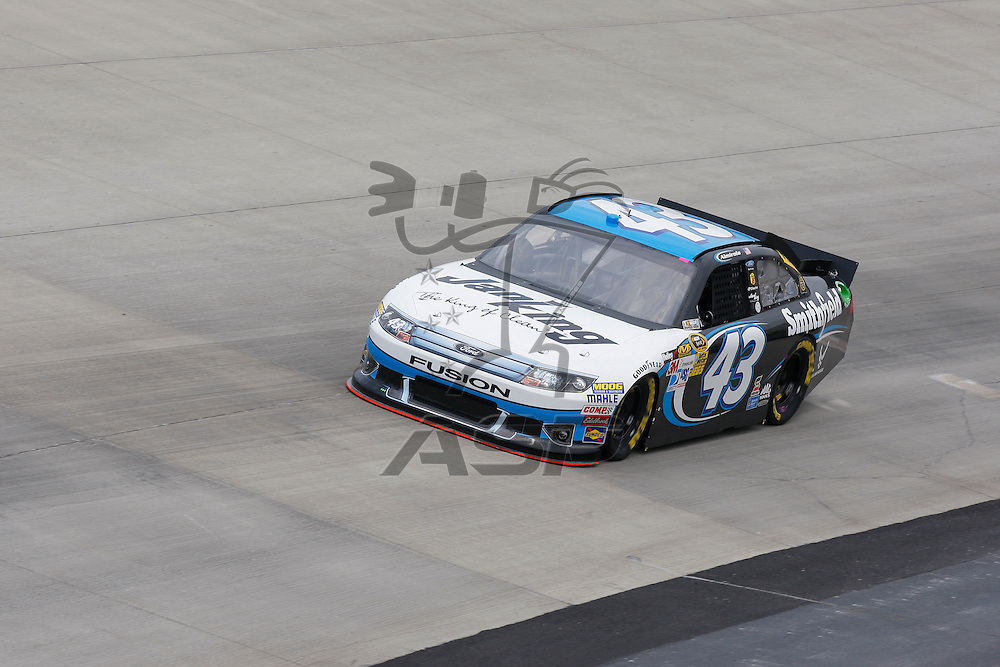 DOVER, DE - JUN 01, 2012:  Aric Almirola (43) brings his Jani-King on the track for a practice session for the FedEx 400 Benefiting Autism Speaks at the Dover International Speedway in Dover, DE.