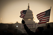 WASHINGTON, DC -- 1/21/13 -- Arnold Monroe, of Tracy, CA (510-681-6454, reneejmonroe@comcast.net), waves a flag just after dawn on the mall...IInaugural events on the National Mall. Spectators gather on the Mall to witness the swearing in.… by André Chung #AC1_5085