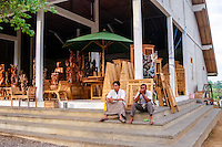 Bali, Gianyar, Mas. For woodcarvings and furniture of good quality Mas is the place. Many shops like this one can be found along the main road.