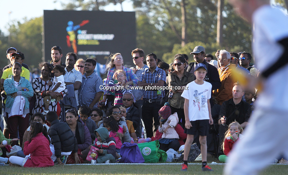 Crowds watch young fans playing cricket at the ICC Cricket World Cup Opening Ceremony venue staged in Hagley Park, Christchurch. 12 February 2015 Photo: Joseph Johnson / www.photosport.co.nz