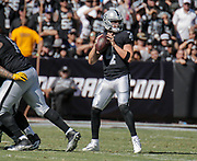 Oct 09 2016 - Oakland U.S. CA -Raiders quarterback Derek Carr #4 game stats comp 25/ att 40 for 317 yards, 2 tds, 1 int and was sacked 3 times during the NFL Football game between San Diego Chargers and the Oakland Raiders 34-31 win at O.co Coliseum Stadium Oakland Calif. Thurman James / CSM