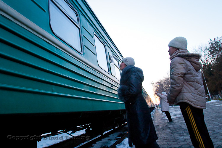 Kyrgyzstan: A train departs Bishkek for Kazakhstan. Many young men leave for Kazakhstan and Russia in search of work. But with the global economic slowdown, they are having increasing troubles finding jobs abroad. December 2008.